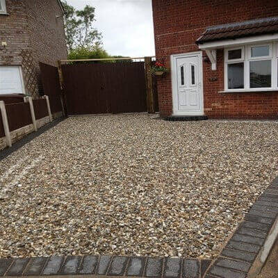 The most important thing you can do when you're getting ready to build a gravel driveway is to take care of site preparation