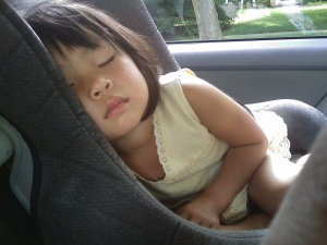 a toddler sleeping in car