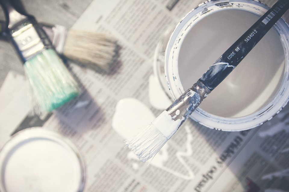 Paint and brushes because repainting is one of those home improvements to make before you move in.