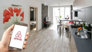 An airbnb app on a mobile phone used to find and rent an apartment in Europe.