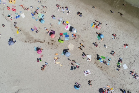 A heat on the beach showing that summer is not the perfect time for moving house in New Jersey.