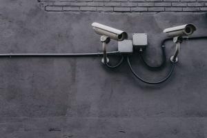 Surveillance cameras on a wall.