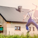 A builder jumping with happiness after finding an ideal home in one of the elite neighborhoods in Bellevue.