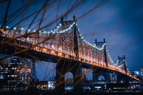 Ed Koch Queensborough Bridge at night in one of the most famous NYC neighborhoods.