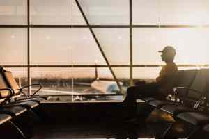 a man on an airport ready for living and working abroad