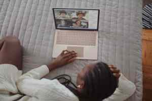 a woman using a laptop to stay in touch with her friends