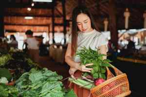 A young woman buying at the market in one of the Washington State cities that hipster culture fans will simply love.