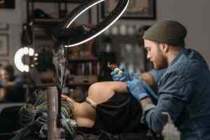 AThe process of making a tattoo.