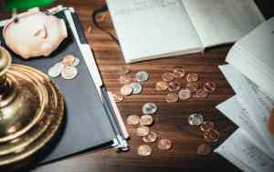 coins and papers scattered on a desk