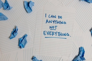"""A piece of paper with the words """" I can ddo anything not everything"""" on it."""